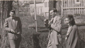 Vintage image of Robie and Flannery O'Connor outside, laughing at something.