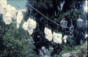 a row of hanging masks