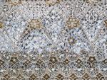 heavily ornate lattice covering.