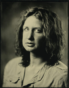 Tintype image of Cyan James looking at the viewer