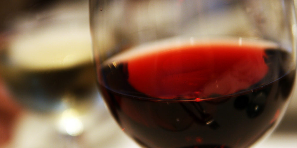 close up of a glass of red wine.