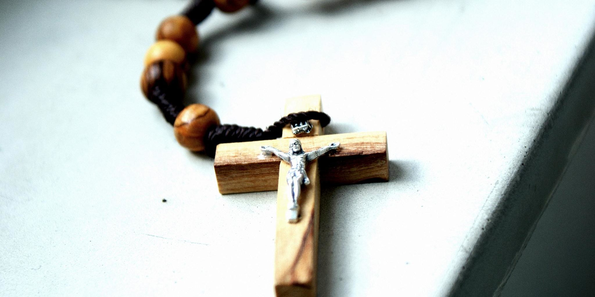 image of a wooden rosary with a wooden crucifix