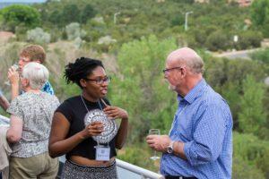 Glen Workshop Bob Denst Esther talking to a man
