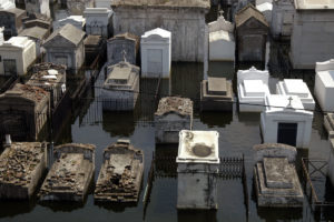 New Orleans, LA 9/5/05 -- A cemetery is swamped with floodwaters from hurricane Katrina. The cemeteries are above ground here due to the high water table. Photo by: Liz Roll