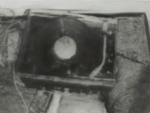 Plate 1. Gerhard Richter. Record Player, 1988. Oil on canvas. 24 ½ x 32 ¾ inches. From October 18, 1977, a series of fifteen paintings. Collection of the Museum of Modern Art, New York.