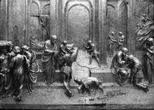Image of Lorezno Ghiberti's Gates of Paradise. People stand in front of a large arched door.