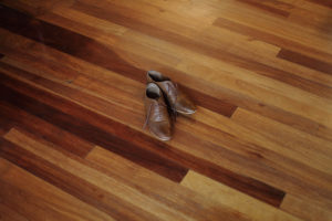 a pair of nice shoes in the center of the floor.