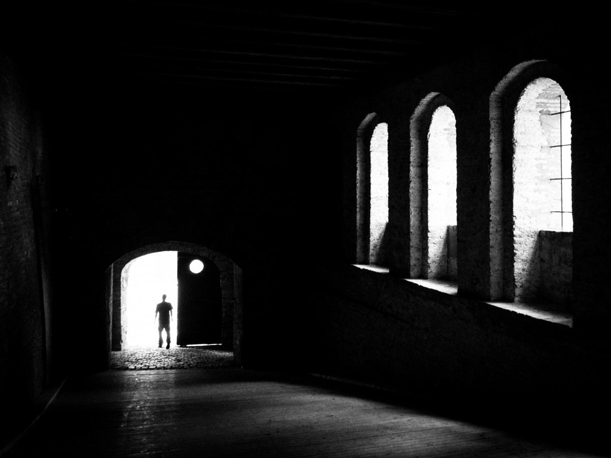 silhouette of man in doorway, black and white photo via creative commons