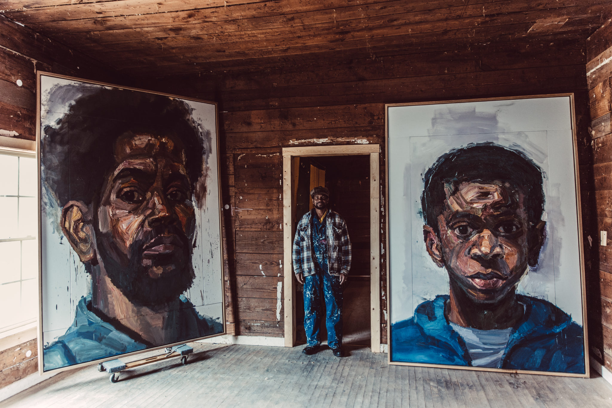 Sedrick Huckaby in Big Momma's house (Photo: Rambo). Pictured with: Daddy and Rising Sun, 2013. Oil on canvas. Each 72 x 48 inches.