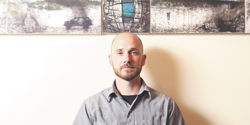 "Artist Scott Kolbo poses for a photograph near ""Inga Landscape"", at Tinman Gallery, in Spokane, Wash., on Thursday, June 21, 2012. (Young Kwak/The Pacific Northwest Inlander)"