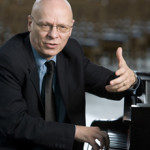 "Professor Jeremy Begbie, director of Duke Initiatives in Theology & the Arts, leads a class discussion on the film, ""The Passion Of The Christ,"" and later, plays the piano in Goodson Chapel. Also, in 017-024, Begbie chats with students after class. For Divinity magazine story about theology and the arts led by new professor Begbie."